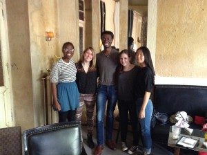 "Here you see from left to right: Miranda Hayman, Eliza Loomis, Alumnus James Gardner, Angela Reiss, and Hein Jeong in café ""Wohnzimmer,"" their favorite one in Berlin. The four women are studying in Berlin with our Duke in Berlin program."